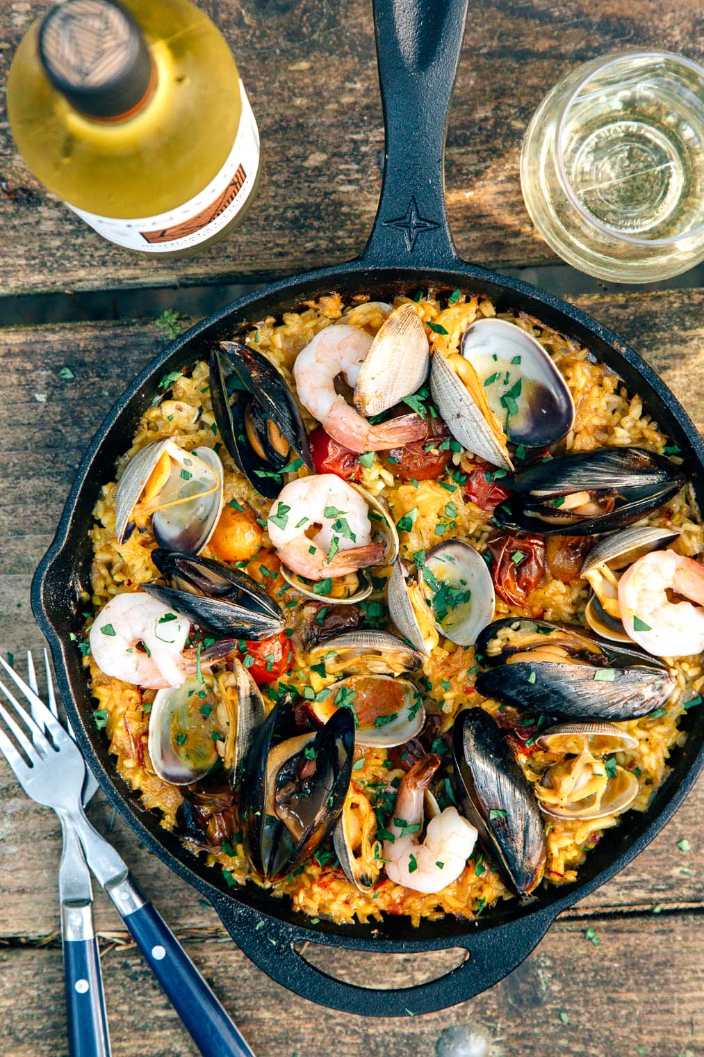 Paella in a cast iron skillet on a camp table