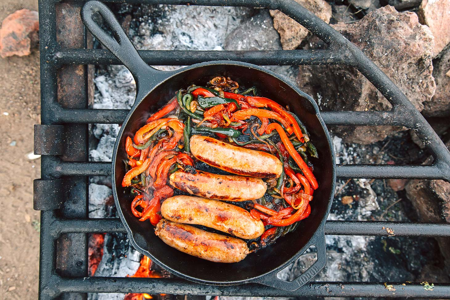 cast iron brats with peppers and onions fresh off the grid