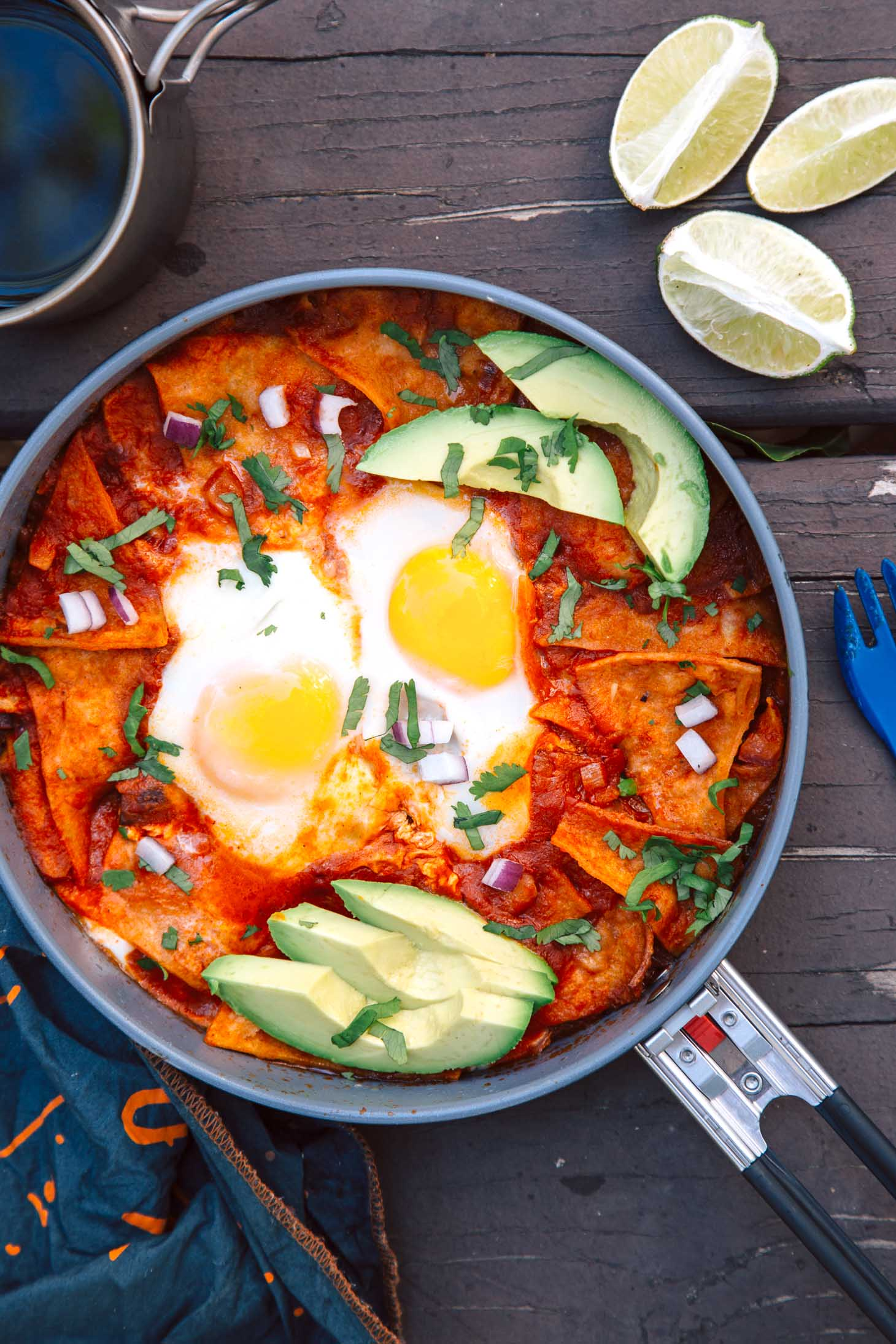 Chilaquiles is an easy camping breakfast idea - crispy tortillas simmered in a spicy tomato sauce and topped with eggs. It takes less than 30 minutes to make, and it's vegetarian, too!