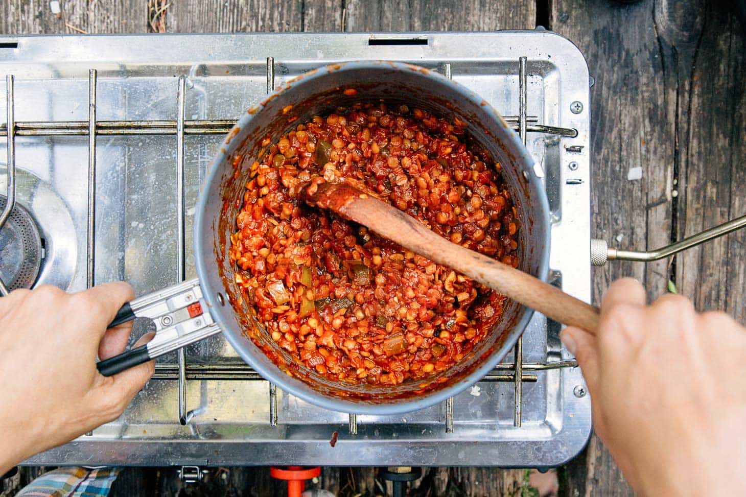 Red lentil sloppy joes filling cooking in a pot on a camping stove